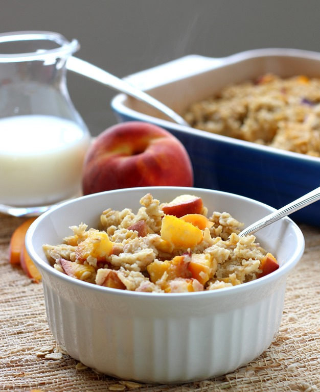 Peaches and Cream Baked Oatmeal- made with fresh juicy peaches and almond milk, this baked oatmeal will keep you full and satisfied for hours. Dairy-free and gluten-free with vegan option!