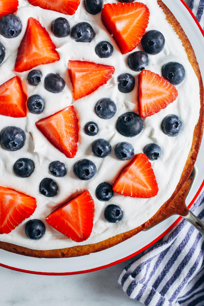 Vanilla Almond Flour Cake with Berries and Whipped Cream- naturally sweetened with a perfect crumb, no one will ever guess this cake is dairy-free and gluten-free!
