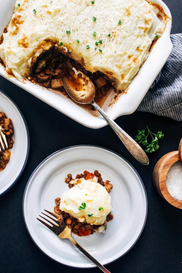 Vegan Lentil Shepherds Pie- a plant-based take on the comforting classic made with lentils, mushrooms and red wine. Topped with parsnip mashed potatoes for even more flavor! (gluten-free)