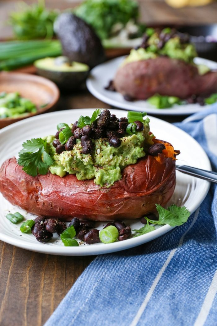Guacamole Black Bean Loaded Sweet Potatoes from The Roasted Root
