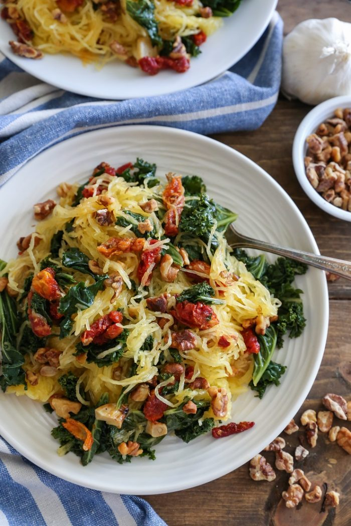 Roasted Garlic & Kale Spaghetti Squash with Sundried Tomatoes from The Roasted Root