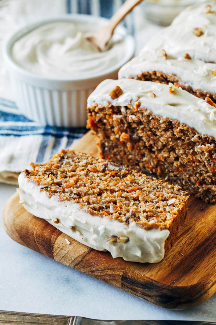 Vegan Banana Carrot Bread with Cashew Cream Cheese Icing- banana replaces egg in this recipe for a lighter take on carrot cake with irresistible flavor. Whole grain, refined sugar-free and dairy-free!