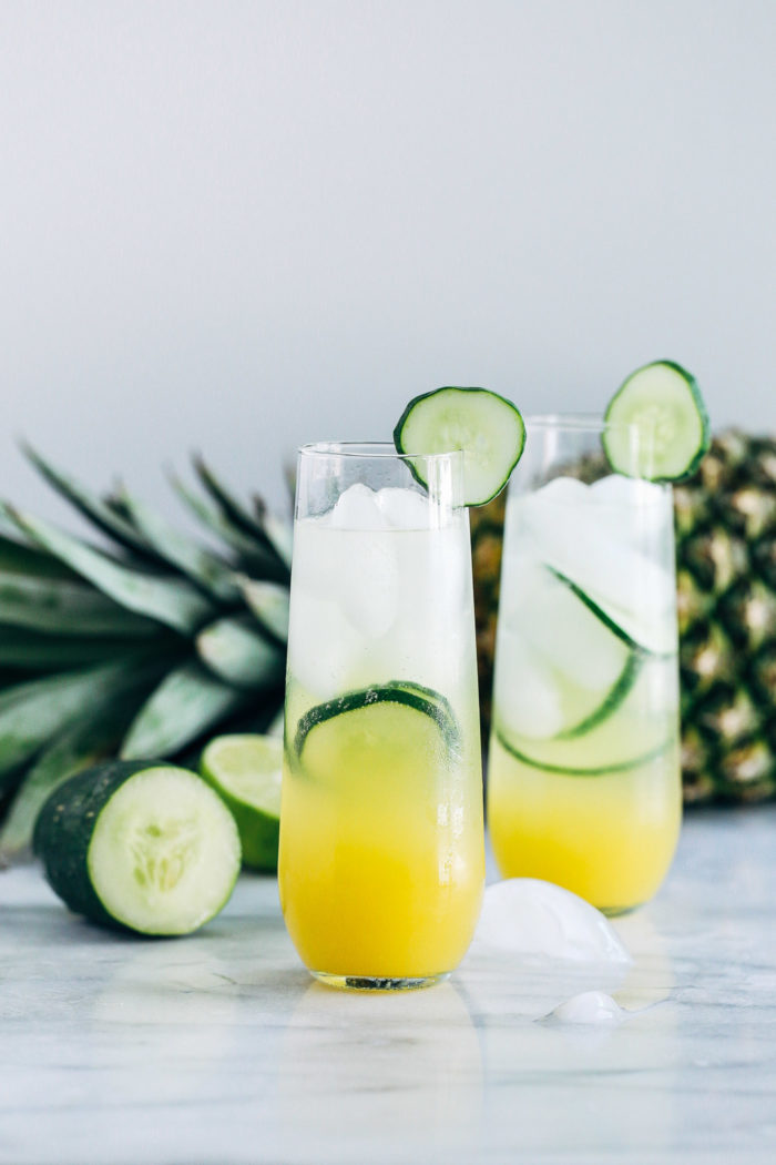 Pineapple Cucumber Lime Spritzers- pineapple juice served with cucumber lime infused sparkling water makes for a light and refreshing drink that's perfect for summer!