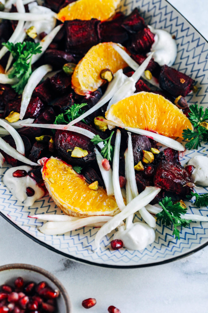 Citrus Glazed Beet Salad with Cashew Cream- fresh beets roasted in a simple citrus glaze and served with fresh fennel, orange segments, crushed pistachios and a silky cashew cream. Perfect for entertaining or to serve as a healthy side item. (vegan, gluten-free + grain-free)