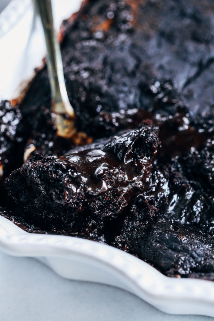 Hot Fudge Chocolate Avocado Cake- made with whole grain flour, coconut sugar and ripe avocado, you'd never guess this sinful dessert is vegan and oil-free!