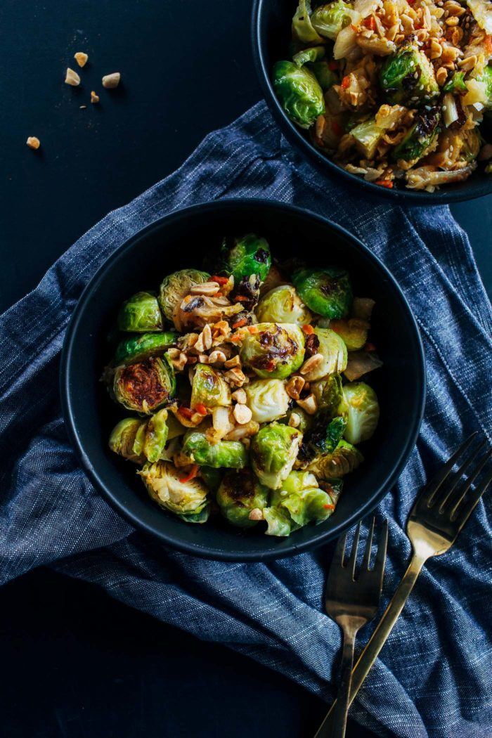 Kimchi Brussels Sprouts- brussels sprouts roasted in a 'cheesy' sauce and served with kimchi and crushed peanuts. Addictingly delicious and packed full of gut friendly probiotics.