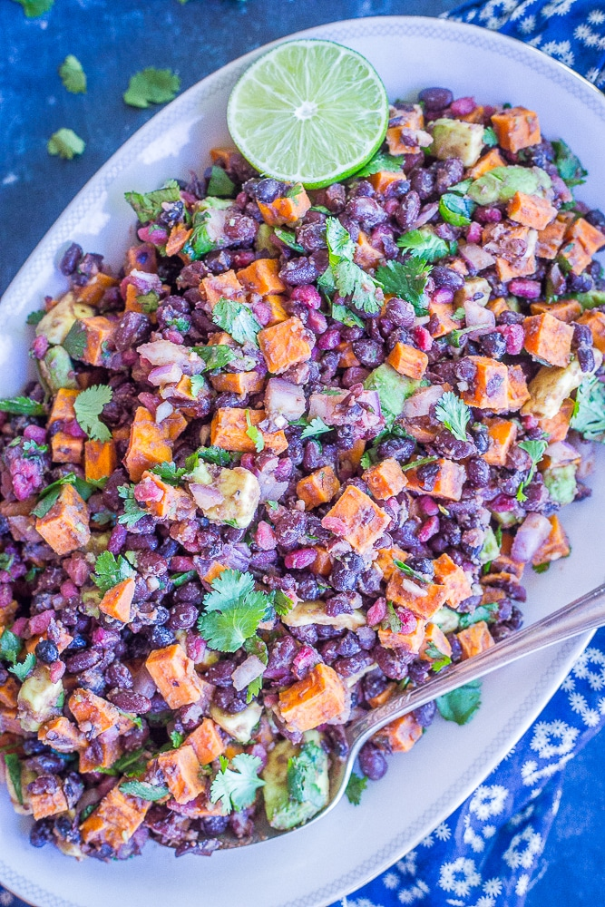 Roasted Sweet Potato Salad with Pomegranate, Black Beans and Avocado from She Likes Food