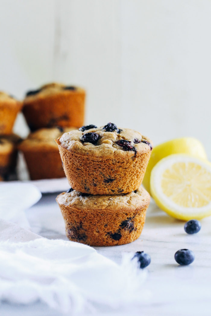 Vegan and Gluten-free Blueberry Muffins- made with whole grain oat flour and almond flour, you'd never guess these muffins are naturally sweetened and and oil-free! #plantbased