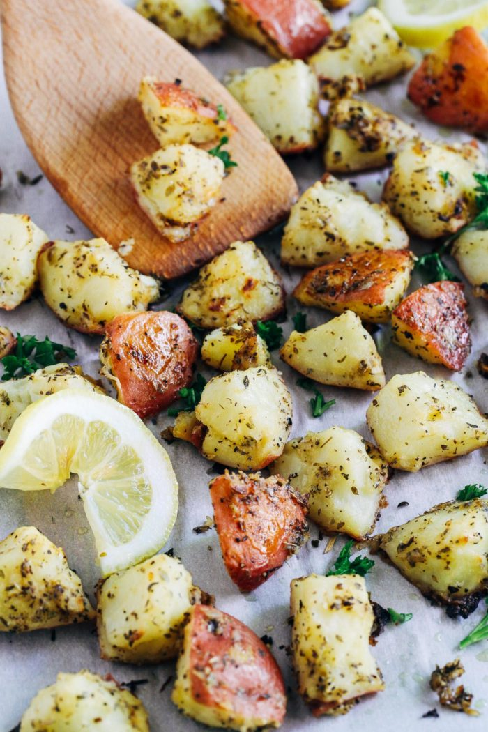 Greek Lemon Roasted Potatoes- tossed in a mixture of olive oil, lemon, mustard, and herbs, these crispy gems are sure to become your new favorite way to eat potatoes!