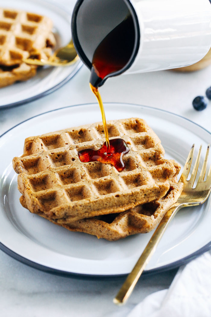 Vegan Gluten-free Oat Flour Waffles- all you need is 10 ingredients to make these crispy vegan waffles. You would never guess they are naturally gluten-free and oil-free too! #vegan #plantbased