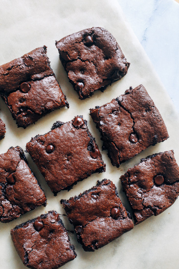 Flourless Vegan Tahini Brownies- made in one bowl with just 10 ingredients, these chewy brownies are super rich and fudgy. You would never know they're grain-free, nut-free, egg-free and dairy-free!