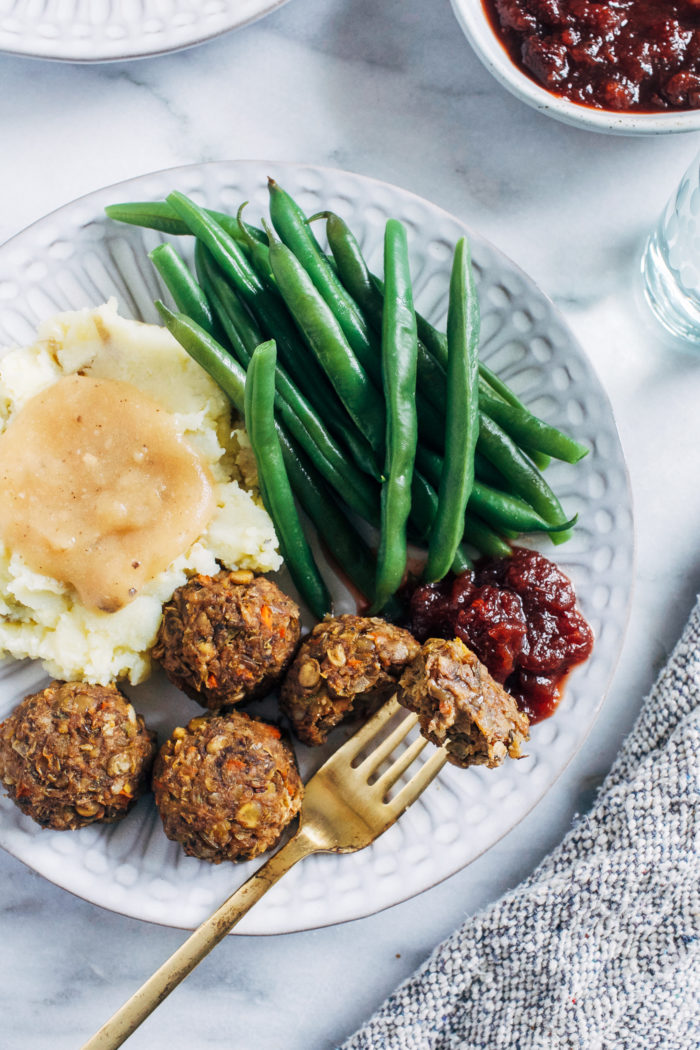 Vegan Thanksgiving 'Meatballs'- hearty, satisfying and packed full of umami flavor, these vegan 'meatballs' are gluten-free, grain-free and nut-free. But they're so delicious even the meat eaters will be gobbling them up!