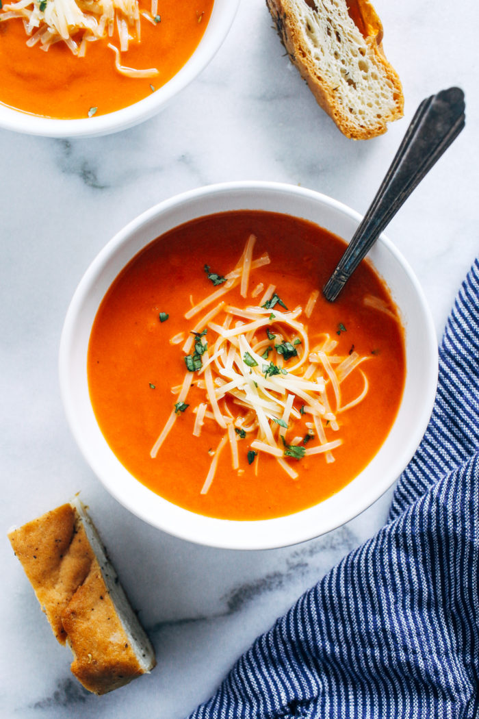 15-Minute Tomato Soup- this easy tomato soup is perfect for when you have a last minute craving. Made with just 8 simple ingredients, you probably have everything you need in your pantry to make it!
